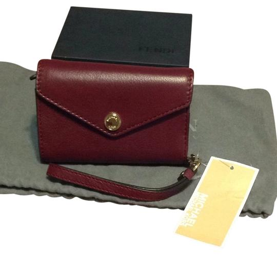 Preload https://item4.tradesy.com/images/michael-michael-kors-burgandy-wristlet-tech-accessory-3731953-0-0.jpg?width=440&height=440