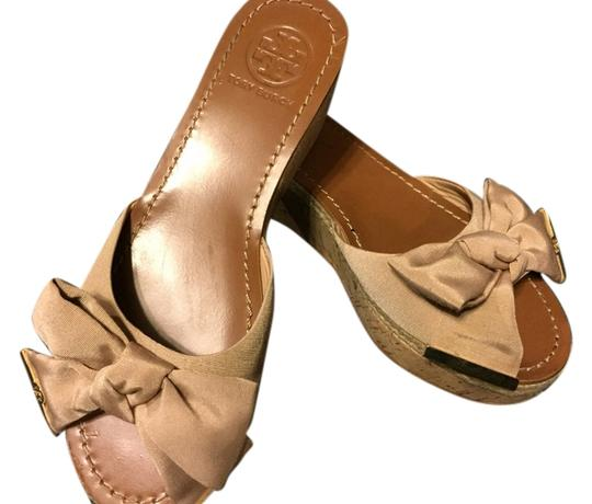 Preload https://item2.tradesy.com/images/tory-burch-champagne-wedges-size-us-7-regular-m-b-3734896-0-0.jpg?width=440&height=440