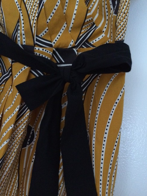 Floreat Top Yellow. White and Black