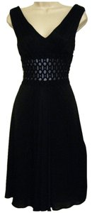 Kay Unger short dress Black V-neck Fit & Flare Knee-length on Tradesy