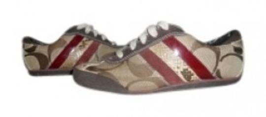 Preload https://item1.tradesy.com/images/coach-tan-and-brown-with-red-stripes-sneakers-snake-skin-detail-sneakers-size-us-75-regular-m-b-37725-0-0.jpg?width=440&height=440