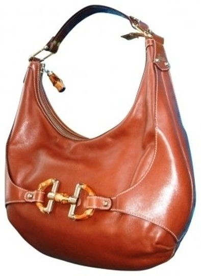 Preload https://img-static.tradesy.com/item/37759/gucci-shoulder-rich-brown-saddle-leather-with-brass-and-wood-accents-hobo-bag-0-0-540-540.jpg