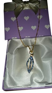 Brand New homemade gold necklace with an authentic Coach leaf charm with blue crystals