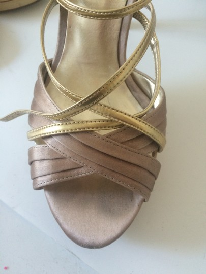 Guess gold/tan Platforms