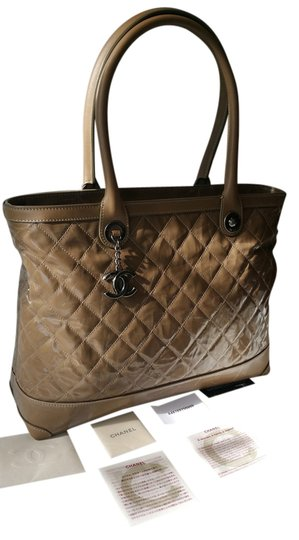 Preload https://item1.tradesy.com/images/chanel-shopping-tote-large-zip-brown-patent-quilted-leather-and-fabric-shoulder-bag-3789160-0-0.jpg?width=440&height=440