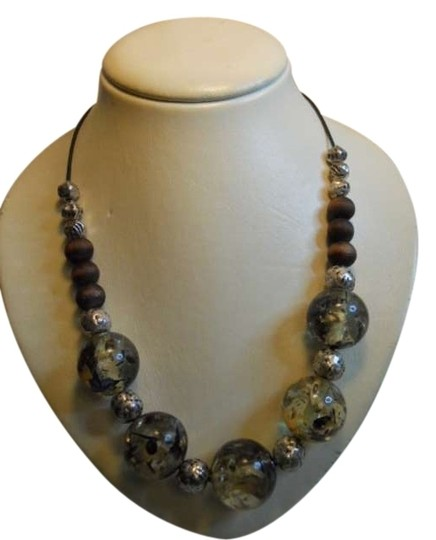 Preload https://item5.tradesy.com/images/chico-s-clear-and-black-leather-cord-necklace-378924-0-0.jpg?width=440&height=440
