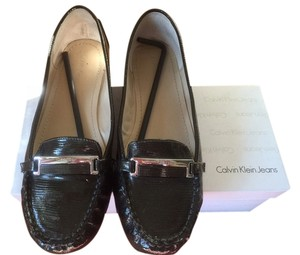 Calvin Klein Amy Burnished Leather Color: 9.5 Whiskey Flats