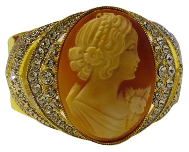 """AMEDEO Goldtone Nyc """"Ottocento"""" 45mm Cornelian Shell Crystal-accented Cameo Arch Bangle Fits 7 To 7.5 Wrist Bracelet AMEDEO Goldtone Nyc """"Ottocento"""" 45mm Cornelian Shell Crystal-accented Cameo Arch Bangle Fits 7 To 7.5 Wrist Bracelet Image 1"""