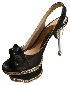 bebe Gold/ Black Platforms