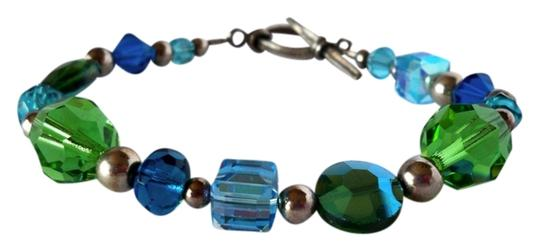Preload https://item2.tradesy.com/images/vintage-iridescent-blue-and-green-glass-beaded-sterling-silver-bracelet-3805441-0-0.jpg?width=440&height=440