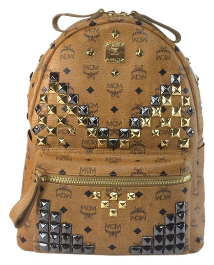Preload https://item2.tradesy.com/images/mcm-stark-m-stud-medium-cognac-brown-coated-canvas-and-leather-backpack-3807226-0-0.jpg?width=440&height=440