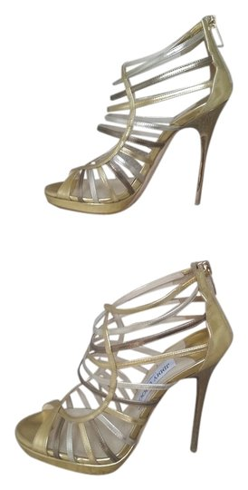 Preload https://item3.tradesy.com/images/jimmy-choo-gold-multi-colour-mirror-leather-sandals-platforms-size-us-75-regular-m-b-3812647-0-2.jpg?width=440&height=440