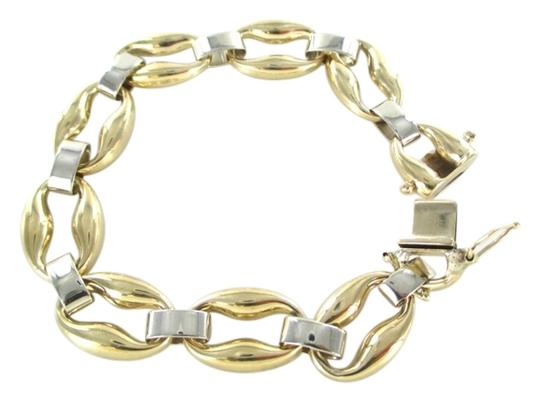 Preload https://item2.tradesy.com/images/gold-14kt-solid-yellow-white-oval-link-pat-fine-bangle-round-bracelet-3824566-0-0.jpg?width=440&height=440