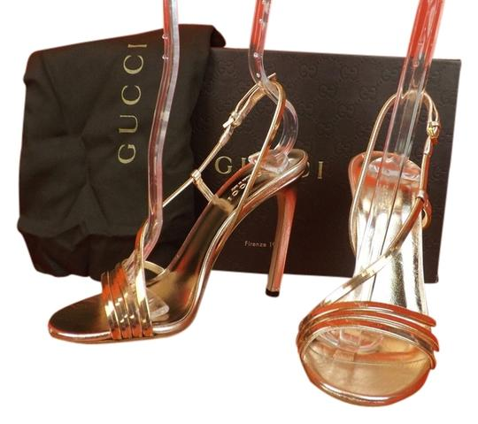 Preload https://item1.tradesy.com/images/gucci-gold-patent-leather-nappa-silk-othilia-cage-evening-365-sandals-size-us-65-regular-m-b-3829375-0-0.jpg?width=440&height=440