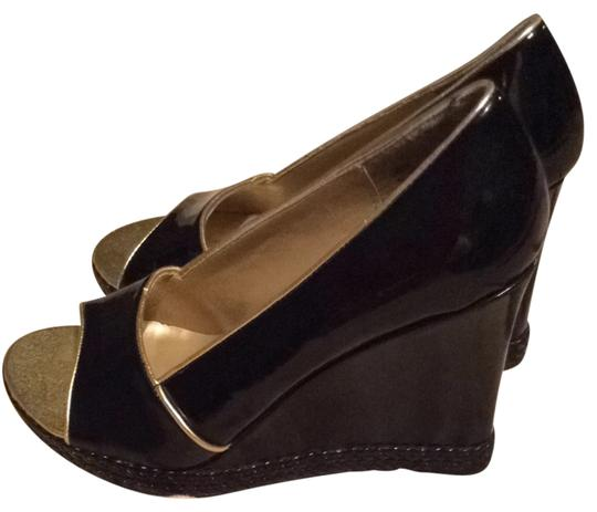 Preload https://item4.tradesy.com/images/metro-7-black-patented-leather-wedges-3832738-0-0.jpg?width=440&height=440