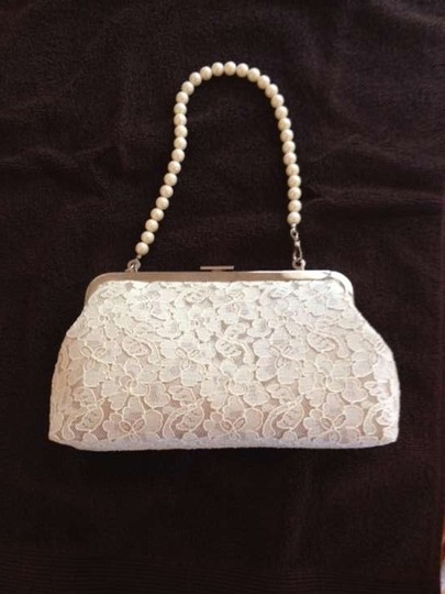 Preload https://item3.tradesy.com/images/off-white-lace-clutch-purse-with-detachable-pearl-handle-bridal-handbag-383387-0-0.jpg?width=440&height=440