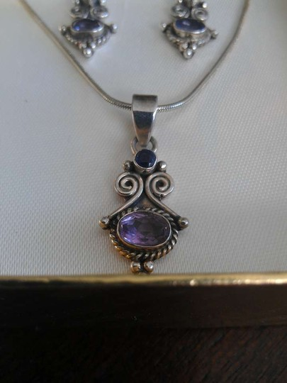 unknown Sterling silver and amethyst necklace and earrings set,