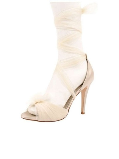 Preload https://item5.tradesy.com/images/ivory-formal-size-us-85-383504-0-0.jpg?width=440&height=440