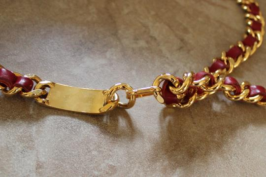 Chanel Gold-tone Chanel chain logo belt with red leather trim