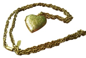 1928 Gold tone heart locket and chain by 1928