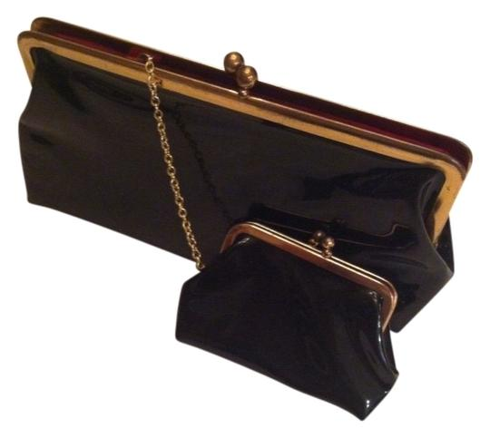 Preload https://img-static.tradesy.com/item/384916/vintage-baby-coin-purse-attached-on-chain-adorable-black-with-red-lining-faux-patent-lined-in-fabric-0-0-540-540.jpg