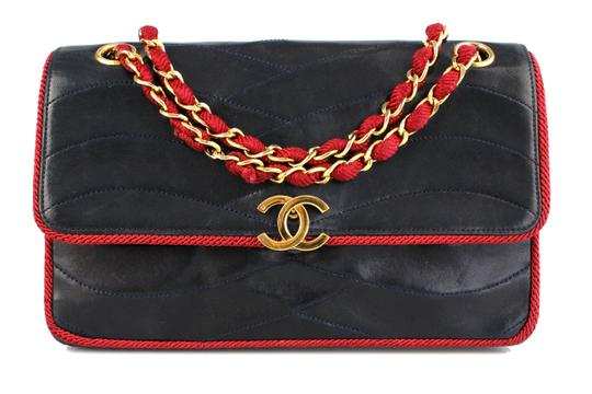Preload https://item1.tradesy.com/images/chanel-with-nylon-flap-navy-blue-and-red-leather-shoulder-bag-3856540-0-4.jpg?width=440&height=440