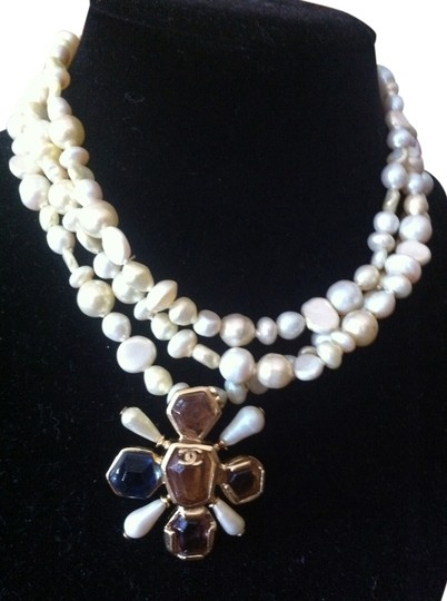Preload https://item2.tradesy.com/images/chanel-pearlbluepurplered-tripple-strand-choker-with-maltese-cross-pendant-w-tag-necklace-3865426-0-0.jpg?width=440&height=440