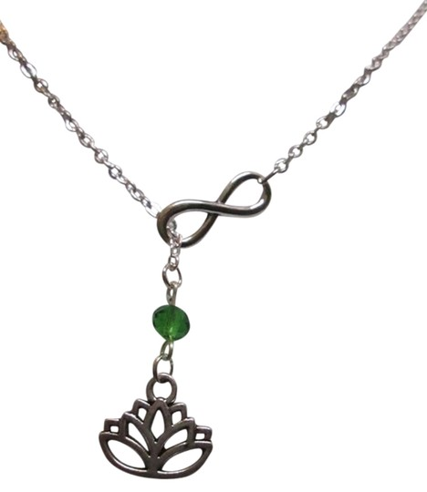 Preload https://item3.tradesy.com/images/other-new-infinity-lotus-flower-blue-crystal-lariat-necklace-ohm-om-wisdom-peaceful-3867637-0-0.jpg?width=440&height=440
