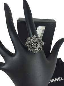 Chanel New ONE OF A KIND Chanel dark rhodium logo cocktail ring