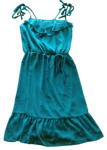 dELiA*s short dress Turquoise Blue Ruffle Spaghetti Strap Flirty on Tradesy
