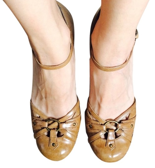 Preload https://item3.tradesy.com/images/classified-tan-wedges-3889192-0-0.jpg?width=440&height=440