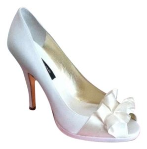Nine Ivory Pumps