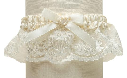 Preload https://item5.tradesy.com/images/mariell-ivory-lace-wedding-garter-with-satin-band-with-pearl-heart-3768g-i-3922084-0-0.jpg?width=440&height=440