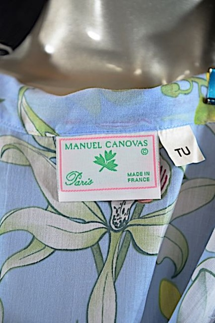 MANUEL CANOVAS Top Light Blue W/multi color floral print
