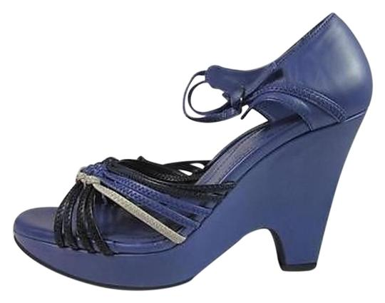 Preload https://item5.tradesy.com/images/tods-purple-leather-wedge-sandals-3936874-0-3.jpg?width=440&height=440