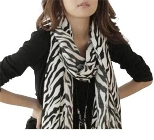 Preload https://item1.tradesy.com/images/all-around-fem-zebra-print-black-and-white-fringed-shawl-fast-shipping-scarfwrap-39700-0-0.jpg?width=440&height=440