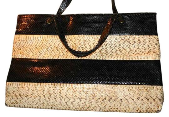 Preload https://item2.tradesy.com/images/black-and-tan-animal-hide-maybe-snakeskin-tote-397796-0-0.jpg?width=440&height=440
