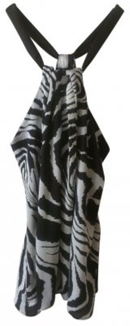 Preload https://item4.tradesy.com/images/charlotte-russe-zebra-print-halter-night-out-top-size-2-xs-39813-0-0.jpg?width=400&height=650