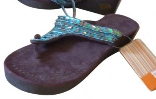 Preload https://item5.tradesy.com/images/tropical-escape-brown-turquoise-sequined-flip-flop-sandals-size-us-9-regular-m-b-39874-0-0.jpg?width=440&height=440