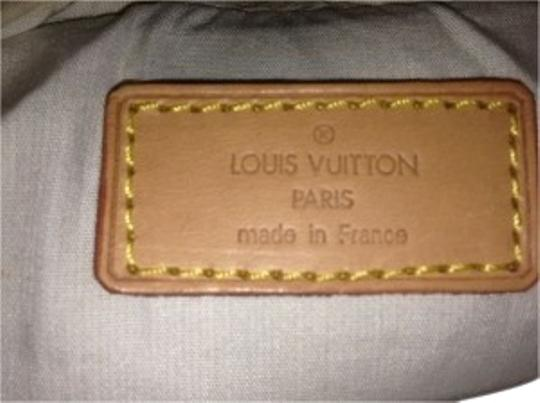Preload https://item2.tradesy.com/images/louis-vuitton-mini-tanbrown-cloth-with-leather-strap-cross-body-bag-39881-0-1.jpg?width=440&height=440