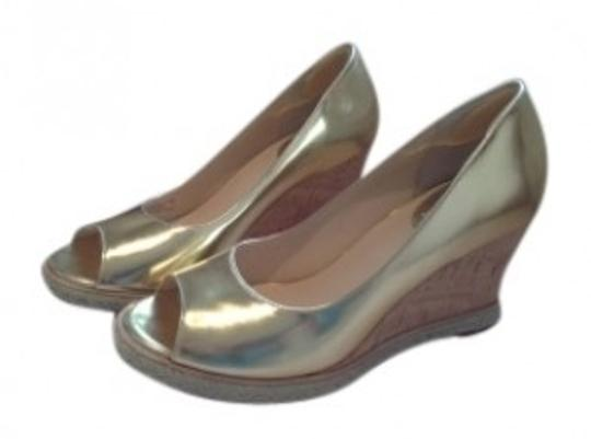 Preload https://item4.tradesy.com/images/cole-haan-gold-style-pump-wedges-size-us-85-regular-m-b-39908-0-0.jpg?width=440&height=440