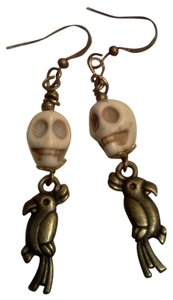 New never worn skull with parrot hook style earrings