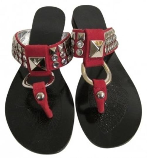 Preload https://item5.tradesy.com/images/naughty-monkey-red-suede-with-rhinestone-and-studded-embell-sandals-size-us-75-regular-m-b-40039-0-0.jpg?width=440&height=440