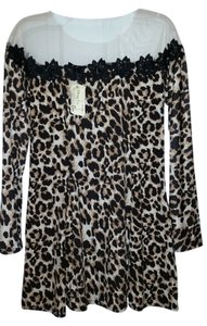 short dress Leopard on Tradesy