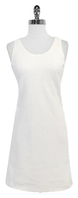 Preload https://item4.tradesy.com/images/chanel-white-cotton-sleeveless-mini-short-casual-dress-size-6-s-4015828-0-0.jpg?width=400&height=650