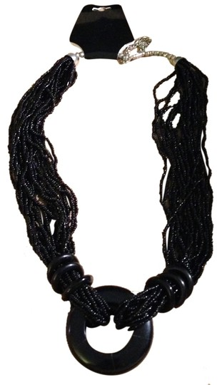Preload https://item3.tradesy.com/images/black-vintage-1980s-polished-glass-beads-with-disc-accents-and-ring-medallion-pendant-multi-strand-a-4018057-0-0.jpg?width=440&height=440