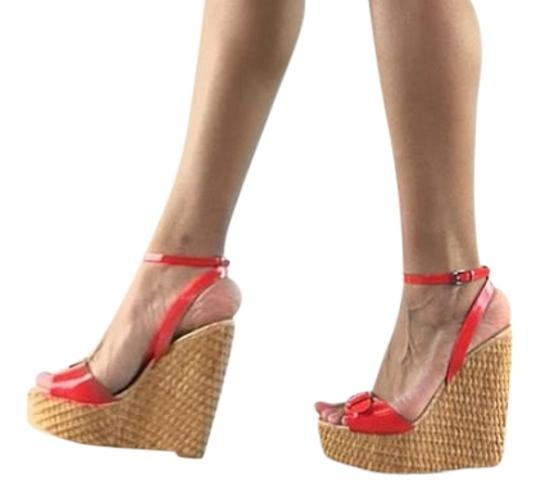 Preload https://item1.tradesy.com/images/penny-loves-kenny-coral-brandi-wedge-patent-sandals-size-us-9-4021405-0-0.jpg?width=440&height=440