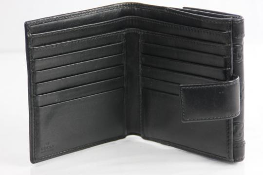 Gucci * Gucci GG Embossed Flap Wallet - Black