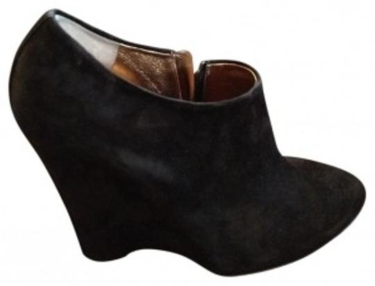 Preload https://item5.tradesy.com/images/dolce-and-gabbana-black-suede-wedge-bootsbooties-size-us-9-regular-m-b-40244-0-0.jpg?width=440&height=440