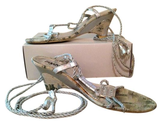 Preload https://item2.tradesy.com/images/silver-sandals-size-us-95-regular-m-b-4027891-0-0.jpg?width=440&height=440